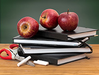 apples on a stack of books
